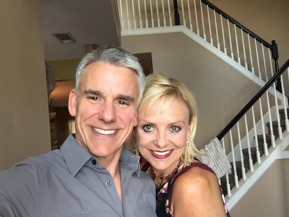 Bill Westlake And His Wife Smile At Home